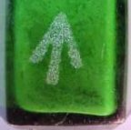 close-up of green bottle with acid etched arrow